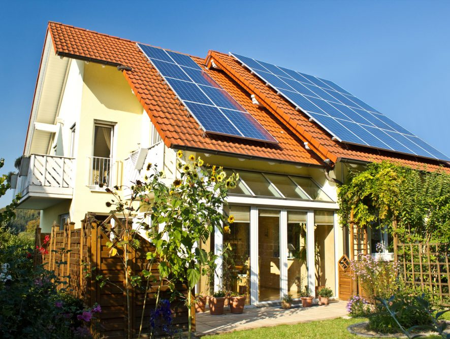 Solar panels on roof of house in late summer